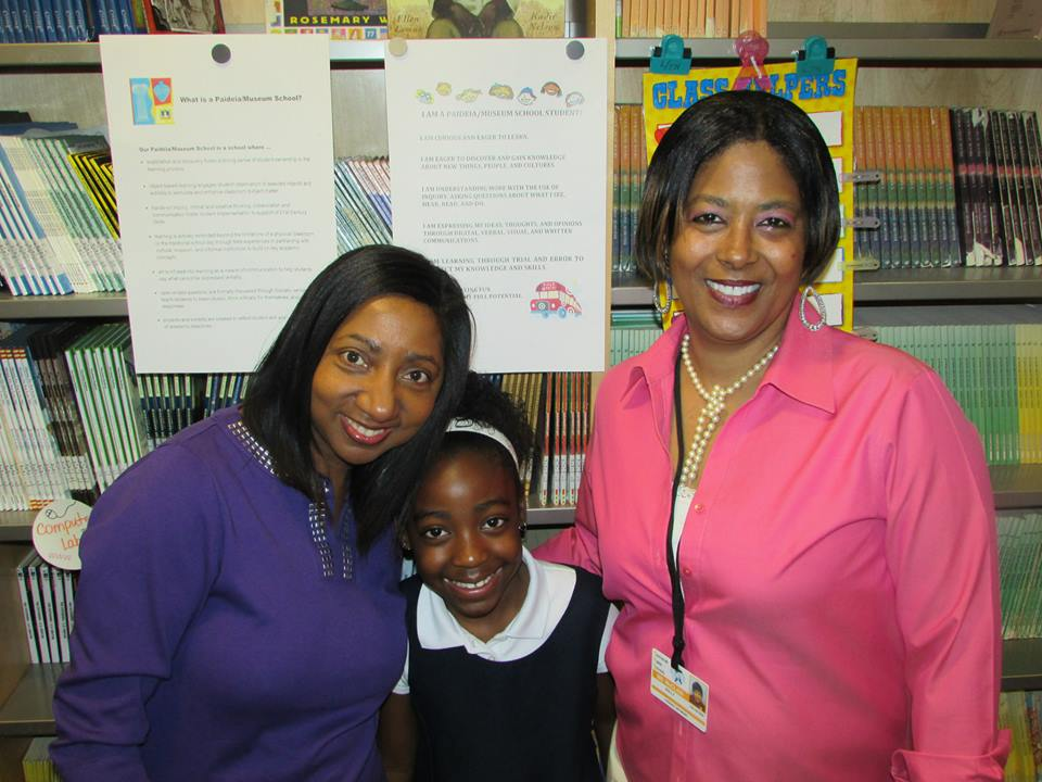 Silverton Paideia Academy third grade teacher Benita Mudd, third-grader and grand daughter of Holly McClain, Aniyah Lumpkin, and Winners Walk Tall character coach Holly McClain enjoy the weekly lesson with their class.
