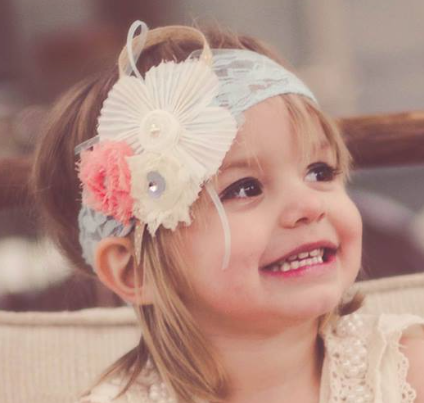 Stay-at-home-mom started a business designing and making glamorous headbands for little girls.