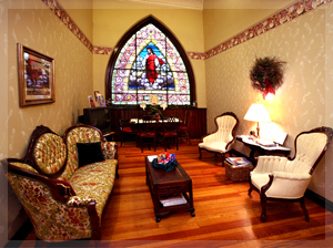 Stained glass windows are featured in each of the three rooms and Christopher's.