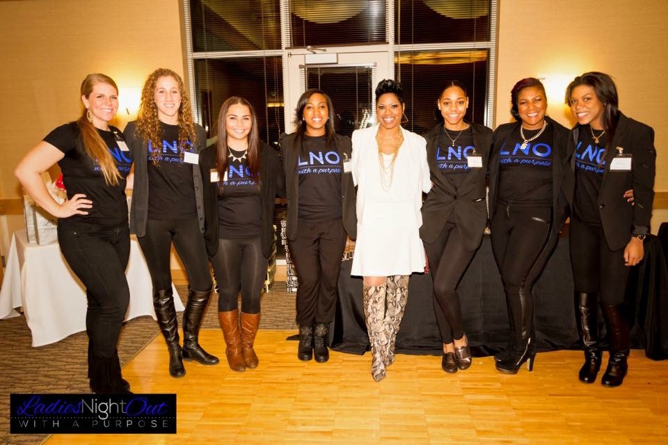 A group shot from the 2014 Ladies Night Out with a Purpose. Photo credit: Amy Elisabeth Spasoff Photography