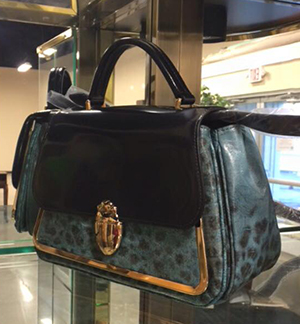 A Tory Burch bag is one of the items available in the online auction supporting High Hopes Auxiliary and The Lindner Center of HOPE.