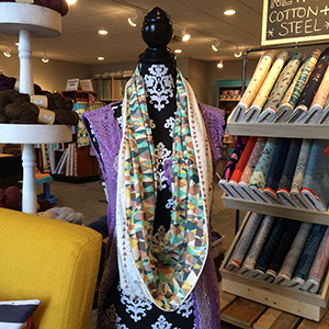 A scarf-neck cardigan made out of jersey knits at a recent Fibergé sewing class