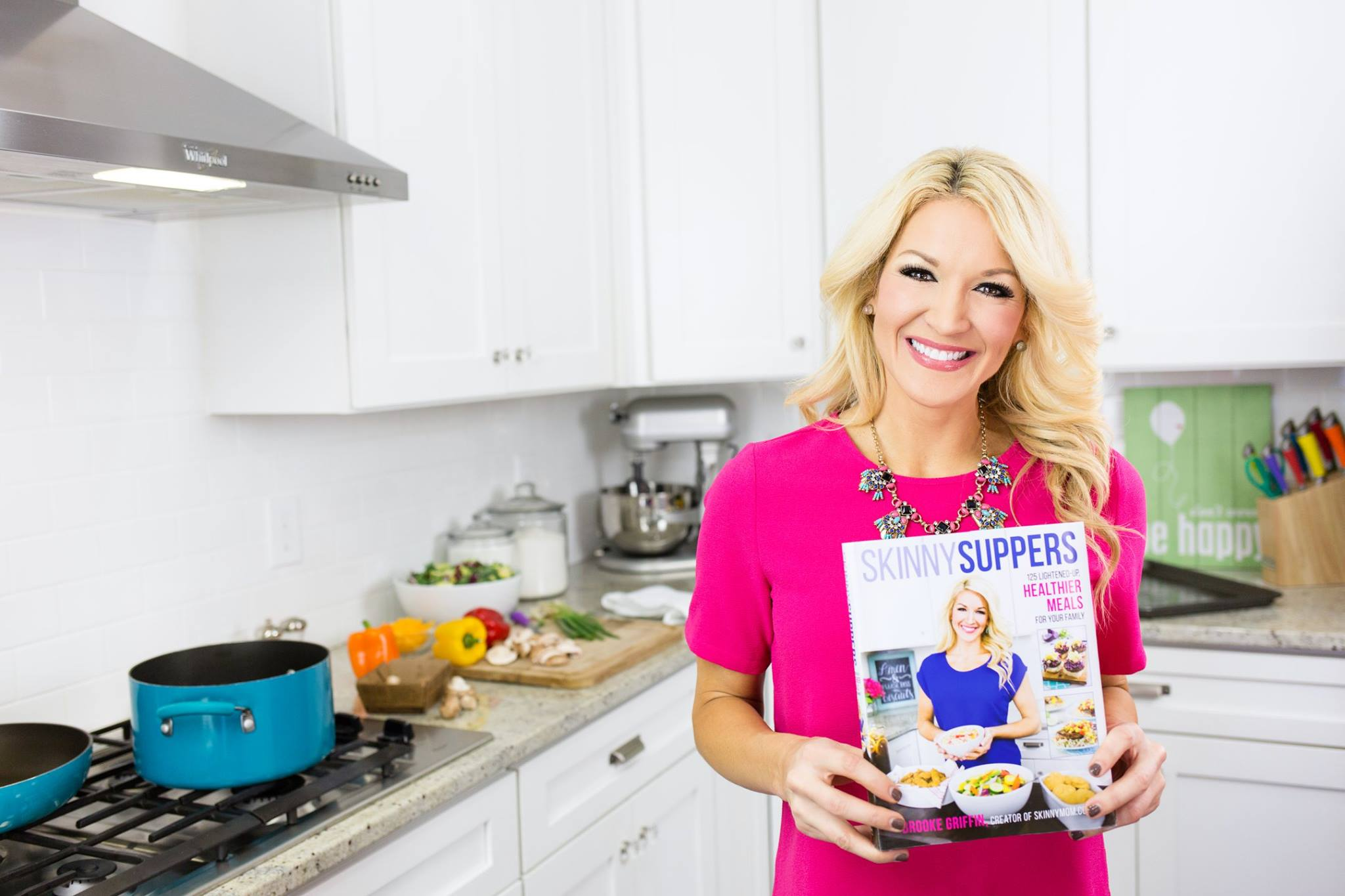 Brooke Griffin, Founder and CEO of Skinny Mom, with her new cookbook Skinny Suppers.