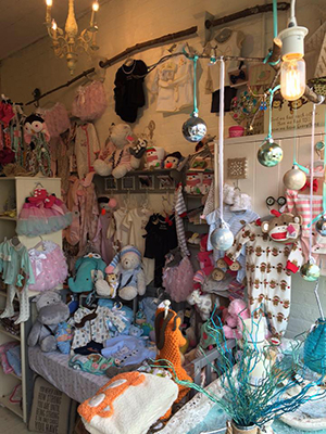 Baby items sold at Diamonds & Dimples Chic Boutique in Bellevue, Kentucky.