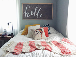 Robinson created this custom sign for her roommate's bedroom.